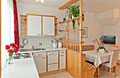 Large kitchen and dining area with dishwasher, microwave oven, mixer, toaster and satellite TV